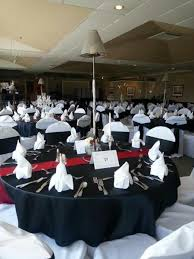 black and red table linens with white chair covers