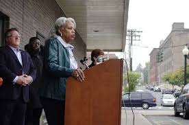 albany county legislature deputy chair wanda willingham addresses those gathered for a press conference outside the
