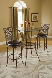 3 pieces dining sets in ancient theme with leather high chair also metal frame and rounded gl table with metal legs