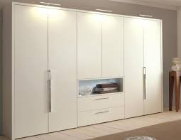 modern fitted bedroom furniture. matte white fitted wardrobe with an integrated open compartment and light system above this modern wardrobeslighting bedroom furniture
