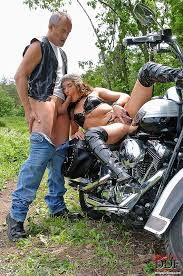 Biker girl sucking cock outdoor