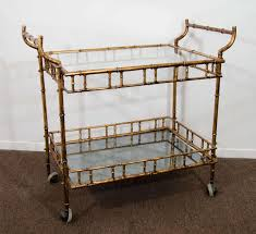 bamboo bar cart. A Vintage Faux Bamboo Gilded Metal Two-tier And Glass Double Handled Bar Cart In R