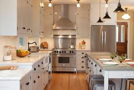 oil rubbed bronze hardware on white cabinets. traditional kitchen idea in new york with a farmhouse sink and stainless steel appliances oil rubbed bronze hardware on white cabinets k
