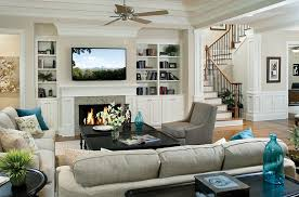 Image Corner Fireplace View In Gallery Pops Of Turquoise Enliven The Traditional Living Room Decoist Tv Above Fireplace Design Ideas