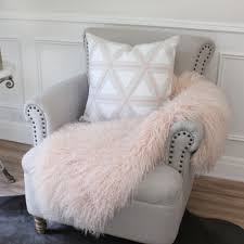 pink tibetan mongolian sheepskin throw fur thrown over chair eluxury home
