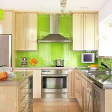Green subway tile backsplash in white kitchen. Eco-friendly 62% recycled  material tiles