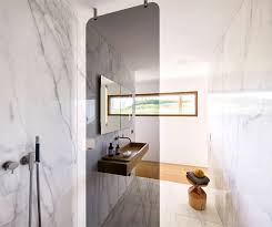 and speaking of marble the beauty of the freestanding tub is back with a flourish gracing the bathrooms design as a freestanding ornament the bathtub is