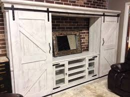 white wash dual barn door entertainment center