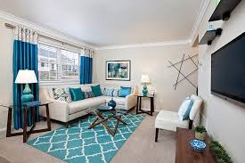 harmonious white living room with blue accents