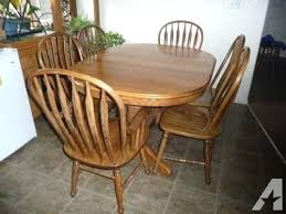 solid oak round dining table 6 chairs wood and used uk brothers 2 leaf extenders furniture