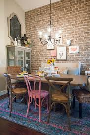 the black goose design eclectic dining room with exposed brick wall mismatched chairs