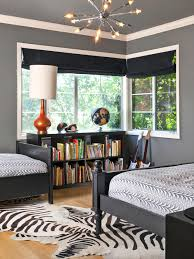 interior zebra rug with black wooden bed and gray bed sheet above feat black wooden