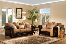 best living room couches brown carpet brown sofa cushions frame vase with plants table lamp end table window