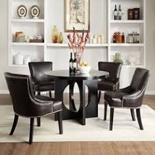 update your dining room with this fortable contemporary brown faux leather round dining set this five piece set feature a round table and four chairs