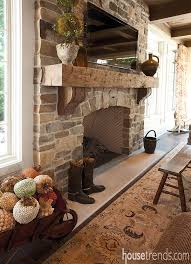a stone fireplace with a rough hewn mantle light up this room with some charm