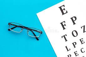 Eye Examination Eyesight Test Chart And Glasses On Blue