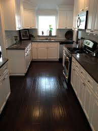 Dark Wood Floors With Medium Wood Cabinets In Kitchen 10x12 Kitchen