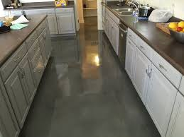 Picture of a recent concrete kitchen floor stained by Barefoot Surfaces