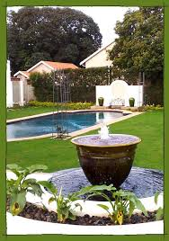 Small Picture Circular water feature and reflective pool in a Formal Garden in