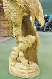 wooden swooping eagle sculpture