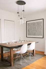 solid wooden table with white modern chairs