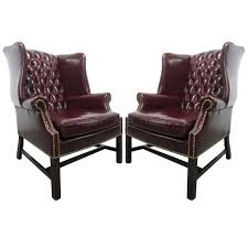 pair of vintage leather tufted wingback chairs for