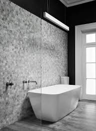 6 the small grey hexagon tiles on the wall of this bathroom don t reach all the way to the top of the wall creating a zigzag pattern where the tiles stop