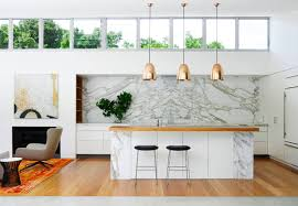 pendant lighting kitchen. Luxury Modern Pendant Lighting Kitchen With Golden Design Over White Marble Island Wooden Countertop