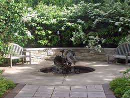 Backyard fountains sunken fountain up close and personal shaped like flowers in a