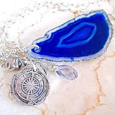 wax seal necklace lost at sea compass with faceted quartz and deep blue geode