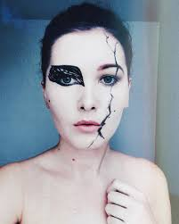 this is a very easy makeup look i was inspired by the black swan so as you can see my face is half white swan and half is black swan so