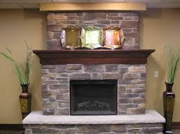 interior grey brick fireplace with dark brown wooden mantel shelf and grey hearth adorable