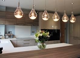 Statement lighting Geometric Handled German Kitchen With Statement Lighting And Gaggenau Appliances Kedleston Interiors Handled German Kitchen With Statement Lighting And Gaggenau