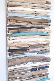 create a beautiful coastal art piece for your wall using driftwood and a cool mix of