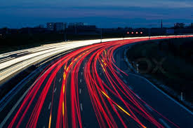 car driving on highway at night.  Driving Many Cars Are Driving At Night On A Highway And Create Light Trails   Stock Photo Colourbox In Car Driving On Highway At Night I