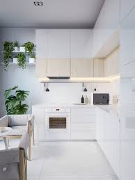 modern kitchen island design. Modern Kitchen Island Designs Minimalist Contemporary White Countertop Under Cabinet Lighting Stove Wood Chair Black Bottle Hanging Rack Pots Plant Vase Design