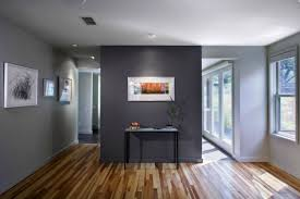 view in gallery dark grey accent wall in a grey room