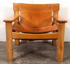 cream leather sling spanish style chairs in the style of børge mogensen