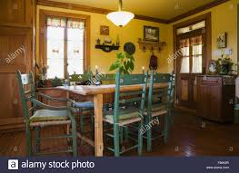 Cottage Style Kitchen Tables Wooden Dining Table With Green High Back Chairs In The Kitchen