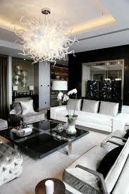 amazing chandelier fixture above black modern square comfortable