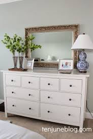 white bedroom dressers. Minimalist White Bedroom Dressers With Indoor Plants On Top Also Desk Lamp And Carved Frame Of Mirror