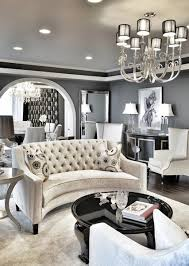 monochrome is a great choice for a formal living room s color scheme for inspiration take a look at this room s shiny black coffee table and black and