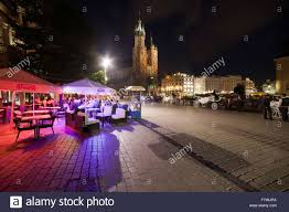 Night in city of krakow poland old town square outdoor cafe restaurant horse carriage coaches cobbled street historic ce