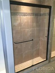 semi frameless sliding shower doors. frameless sliding shower door bore through towel bars and oil rubbed bronze hardware semi doors