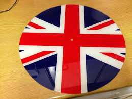 union jack furniture. union jack it was a clock 2 begin with so there is hole in the middle could be hung on wall or plate standit measures 16in diametre union jack furniture s