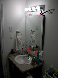the mirror was glued to the wall who does that we were not impressed i researched quite a bit thanks google on how to remove a glued on mirror