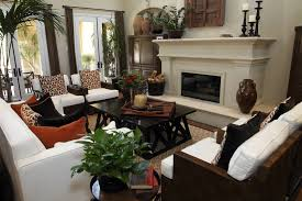 formal living room with three sofas and a dark wood custom coffee table furniture faces