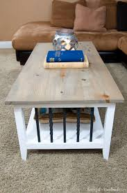 farmhouse coffee table with iron accents and a weathered gray natural stain on the top