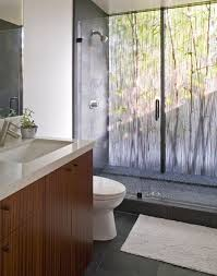 view in gallery dramatic bathroom with beautiful backlit rainforest like acrylic panel and glass doors