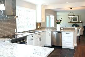 backsplash white cabinets for white cabinets white ice granite in a kitchen with grey tile dark